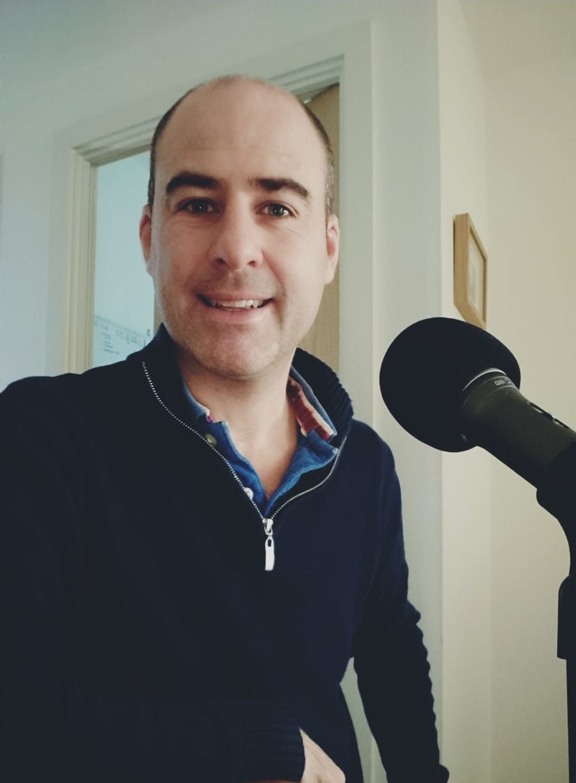 Jon recording his podcast